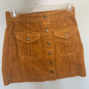 Orange button-up skirt with two pockets